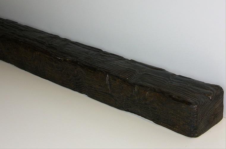 Балка из пенополиуретана цвета темный дуб и фактурой рубленое дерево прекрасно впишется в любой интерьер загородного дома